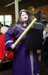 Mistress Anastasia, the Mistress of Organized Mayhem, with her clipboard shield