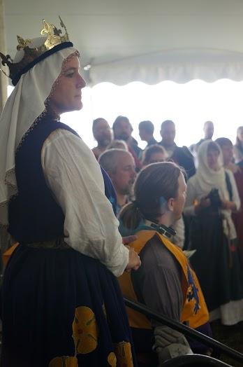 Queen Kiena before her unbelted champions Photo by Baroness Rainillt Leia de Bello Marisco