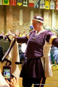 Lord Aleksei Dmitriev won the early period category with the Minnesota Vikings.  The purple tunic and pants represented the home jersey, complete with white legs wraps for the socks and a white kaftan to represent the away jersey. The hat with the appliqued horns matches their football helmet.