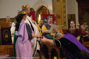 King Brennan and Queen Caoilfhionn swear to protect the Kingdom of the East, sealing their vow on a reliquary containing earth from the First Tournament
