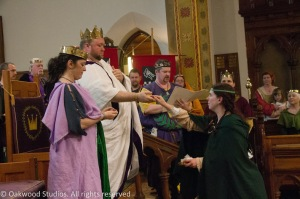 The Queen's Bard presents King Brennan and Queen Caoilfhionn with Their rings, symbols of Imperial power