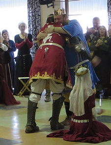 His Majesty and the new prince embrace