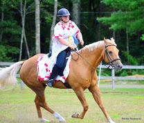 Baroness Doucette de Verdun rides Squire Wilhelm photo by Lavina Attewode