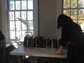 One of the research assistants works to organize the books