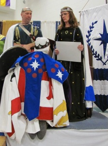 Barom Pellandres is invested as Princess' Rattan Champion of Tir Mara