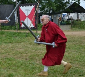 Count Jehan doing boffer fighting at Pennsic with a member of House Sable Maul, which is led by his former Squire Sir Gareth Kincaid.  Count Jehan retired from heavy combat in 2009.