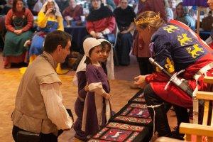 King Edward speaks to the daughter of Mistress Khioniya and Sir Seosamh Photo courtesy of Raziya Bint Rusa