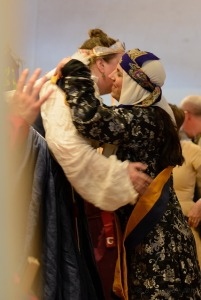 Raziya is welcomed into the Order by Baroness Nicolette.  Photo by Master Albert Faulke of Sandford