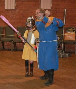 Sir Michael instructing the next generation of Pennsic fighters.  Photo by Lord Trentus
