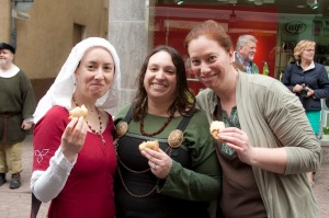 Duchess Thyra, Baroness Phalin and Lady Cecilia enjoy meat pies during the Street Bransles