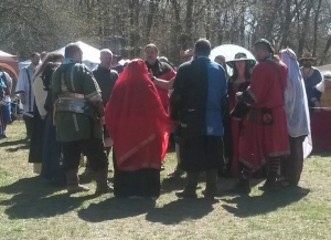 The final combatants and consorts speak with the Crown before the final bought. Photo courtesy Lady Sorcha nic Aoidh