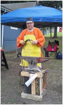 Blacksmithing demonstration by Lord Decklan Gobha.