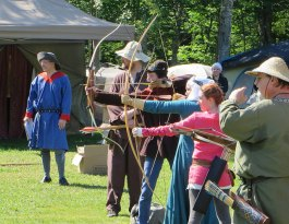 Archers line up to 'shoot' at the rattan fighters at Siege of Castle Theo d'Ore III, Canton of Distant Shore - Photo Courtesy of Lady Cat Lennox