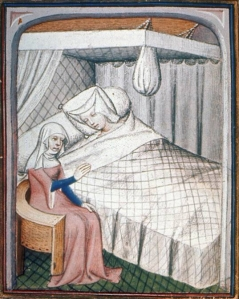 A lady in bed.