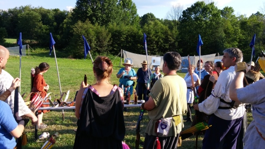 Captain General of Archers Jehannine de Flandres and her staff announce names of East Kingdom Archery Champions team members and alternates this evening on the archery range. Photo by Mistress Ygraine