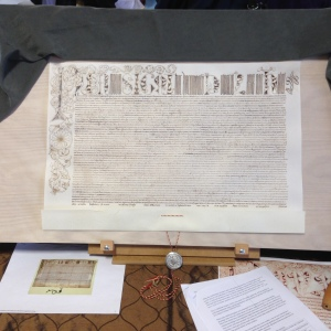 A deliberately forged charter scroll for the College of Scribes of the East Kingdom, based on a 16th Century papal bull. Calligraphy and illumination by Duchess Thyra Eiriksdottir. The seal (not part of competition) was made by the Honorable Lord Aaron the Arrowsmith.