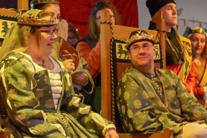 King Wilhelm looks on while Queen Vienna speaks as they sit upon the Thrones of the East during their last court.
